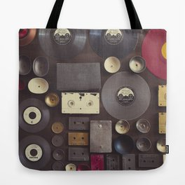 Music. Vintage wall with vinyl records and audio cassettes hung. Tote Bag