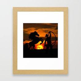 Cowboy at sunset Framed Art Print