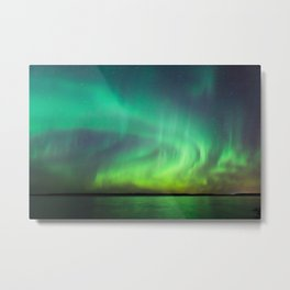 Beautiful northern lights aurora borealis over lake in Finland Metal Print