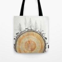 tree rings Tote Bags featuring Tree Rings by dreamshade