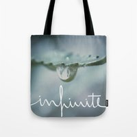 infinite Tote Bags featuring Infinite by Galaxy Eyes