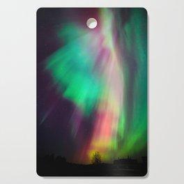 Big beautiful multicolored northern lights in Finland Cutting Board