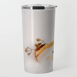 Beautiful golden leaves in the snow Travel Mug