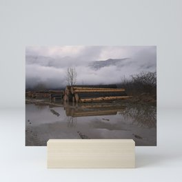 Timber Logs With A Foggy Mountain View Mini Art Print