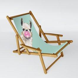 Bubble Gum Sneaky Llama in Green Sling Chair
