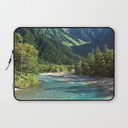 River flowing in front of snow covered mountain Laptop Sleeve