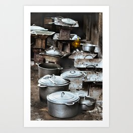 Group of rustic charcoal stoves and cookware, pots and pans on the floor. Art Print