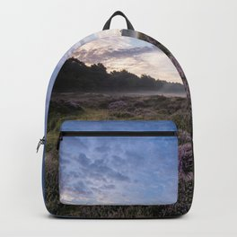 Sunrise at the heather fields Backpack