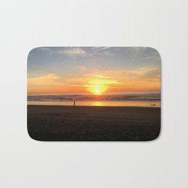 WALKING ON THE BEACH AT SUNSET Bath Mat