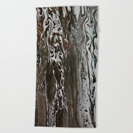 In the southern hemisphere moss grows on the south side of the tree Beach Towel