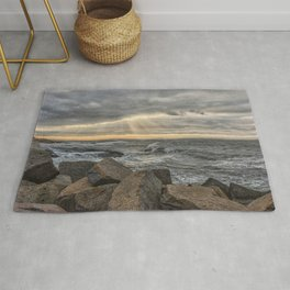 Sunbeams at Lanescove with rough waves Rug