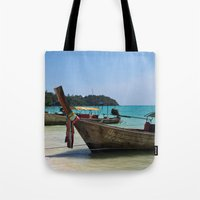 thailand Tote Bags featuring Thailand Boat by Serena Jones Photography
