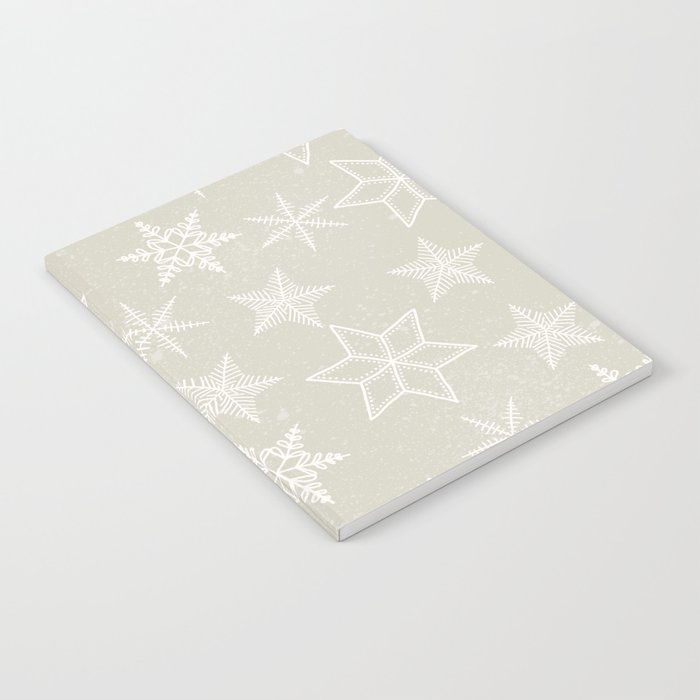 Snowflakes on beige background Notebook