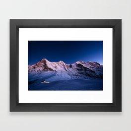 Eiger, Mönch and Jungfrau mountain peaks at dusk. Framed Art Print