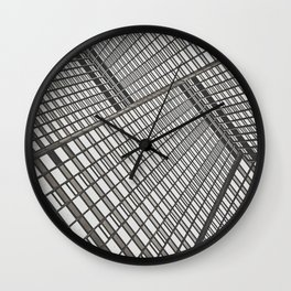 Sky scrapers blocking out the sky Wall Clock