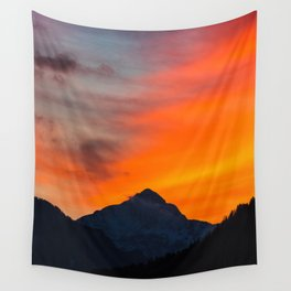 Stunning vibrant sunset behind mountain Wall Tapestry