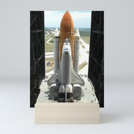 931. Daylight streams through the open doors of NASA's Vehicle Assembly Building Mini Art Print
