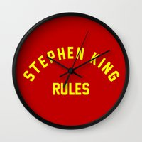 stephen king Wall Clocks featuring Stephen King Rules by Caroline Blicq