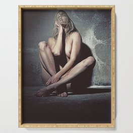 Naked woman in a dark cellar. Image finished with old film grain. Serving Tray