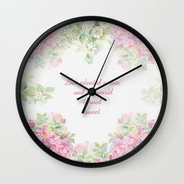 Love planted a rose Wall Clock