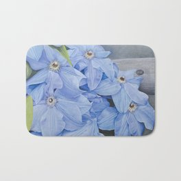 Blue Clematis Flowers on Knotted Fence Post Bath Mat