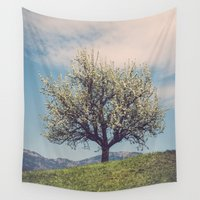 switzerland Wall Tapestries featuring Blossom tree on a hill in Switzerland by mamate