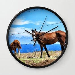 Horses against a blue sky Wall Clock