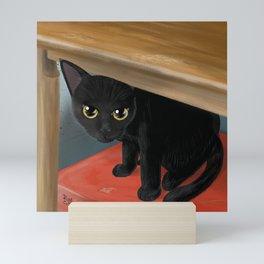 Under the table Mini Art Print