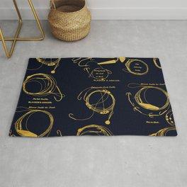 Maritime pattern- Gold fishing gear on darkblue background Rug