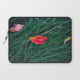closeup orange leaves on the green grass field Laptop Sleeve