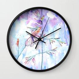 A butterfly on a meadow Wall Clock