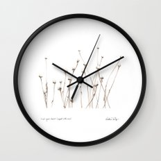 Last year's daisies, topped with snow Wall Clock