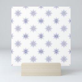 Seamless pattern with blue snowflakes on white background Mini Art Print