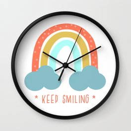 Keep smiling - inspirational quote with rainbow and clouds Wall Clock