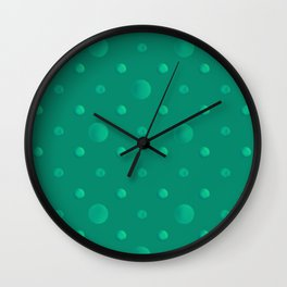 Green polka dots on a green background . Wall Clock