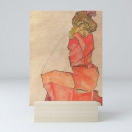Egon Schiele - Kneeling Female in Orange-Red Dress Mini Art Print