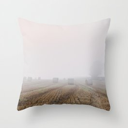 Round bales in a stubble field bound with fog at dawn. Norfolk, UK. Throw Pillow