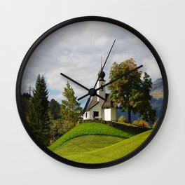 Small chapel in mountains Wall Clock