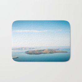 Beautiful landscape with sea view. Cruise liner at the sea near the Nea Kameni, a small Greek island Bath Mat