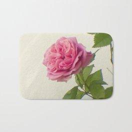 A single rose Bath Mat