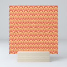 Simple chevron pattern shaded from brilliant orange to yellow Mini Art Print