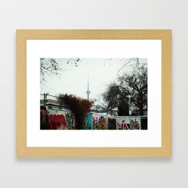 A view of the CN TOWER from kensington market Framed Art Print