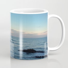 Sunset on  a black rock beach Coffee Mug