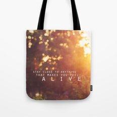 feel alive. Tote Bag