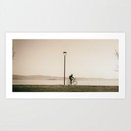 Cycling along the shore of lake Trasimeno Art Print