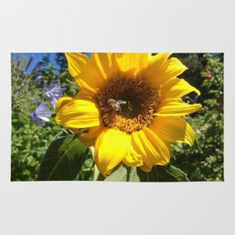 Bee on sunflower Rug