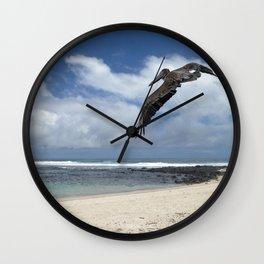 Pelican above the beach Wall Clock