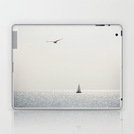 Fly over the sea Laptop & iPad Skin