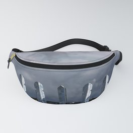 Metal fence with dark clouds Fanny Pack