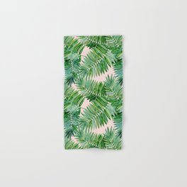 Green palm leaves on a light pink background. Hand & Bath Towel
